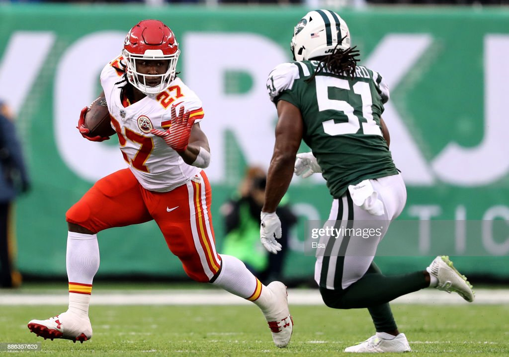 Kareem Hunt #27 of the Kansas City Chiefs carries the ball as Julian Stanford #51 of the New York Jets defends on December 03, 2017 at MetLife Stadium in East Rutherford, New Jersey.The New York Jets defeated the Kansas City Chiefs 38-31.