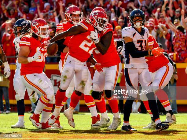 Kareem Hunt of the Kansas City Chiefs celebrates a touchdown after an amazing run during the third quarter of the game against the Denver Broncos at...