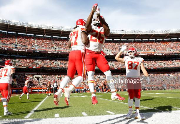Kareem Hunt of the Kansas City Chiefs celebrates his touchdown with Damien Williams during the first quarter against the Cleveland Browns at...