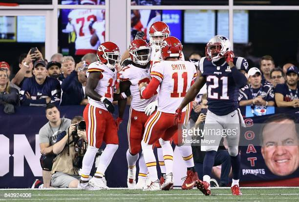 Kareem Hunt of the Kansas City Chiefs celebrates with teammates after scoring a touchdown during the second quarter against the New England Patriots...
