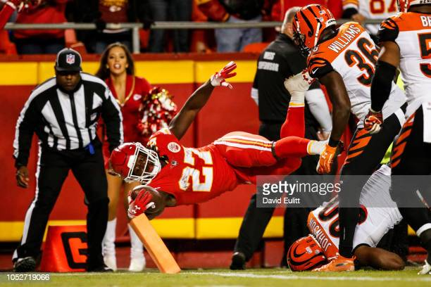 Kareem Hunt of the Kansas City Chiefs dives across the goal line for the second touchdown of the game during the second quarter of the game against...