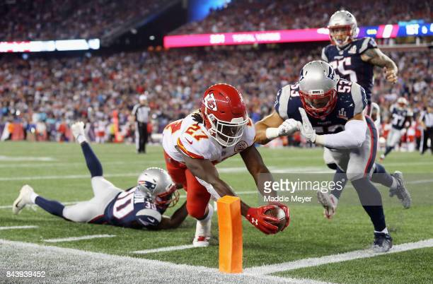 Kareem Hunt of the Kansas City Chiefs dives for the pylon to score a 4yard rushing touchdown during the fourth quarter against the New England...
