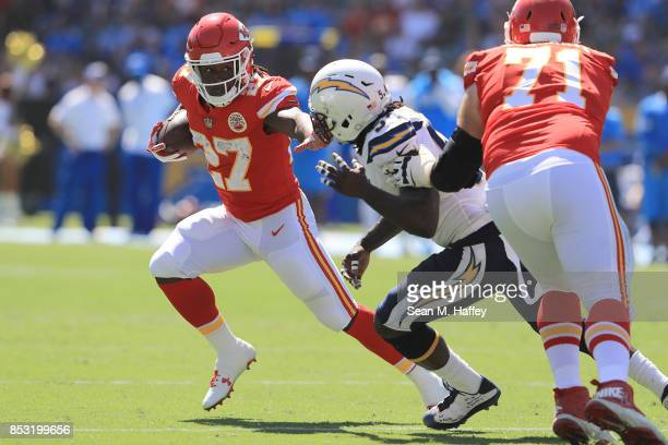 Kareem Hunt of the Kansas City Chiefs eludes Melvin Ingram of the Los Angeles Chargers to gain extra yardage during the NFL game at the StubHub...