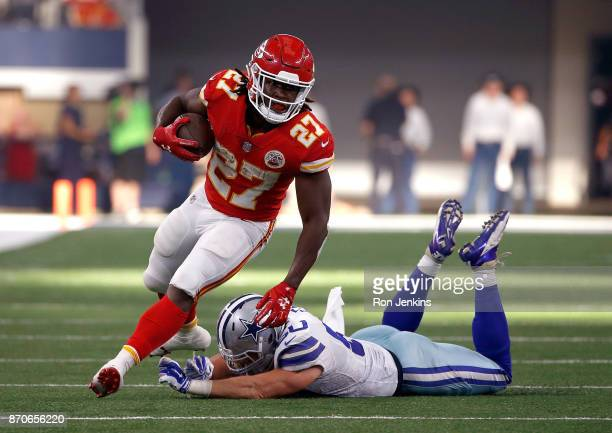 Kareem Hunt of the Kansas City Chiefs gains first down yardage against Sean Lee of the Dallas Cowboys in the second quarter of a football game at ATT...
