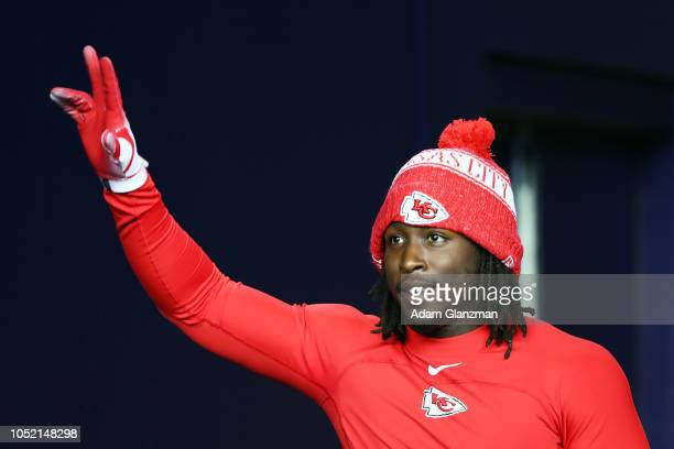 Kareem Hunt of the Kansas City Chiefs gestures before a game against the New England Patriots at Gillette Stadium on October 14 2018 in Foxborough...