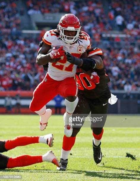 Kareem Hunt of the Kansas City Chiefs gets wrapped up by Emmanuel Ogbah of the Cleveland Browns during the second quarter at FirstEnergy Stadium on...