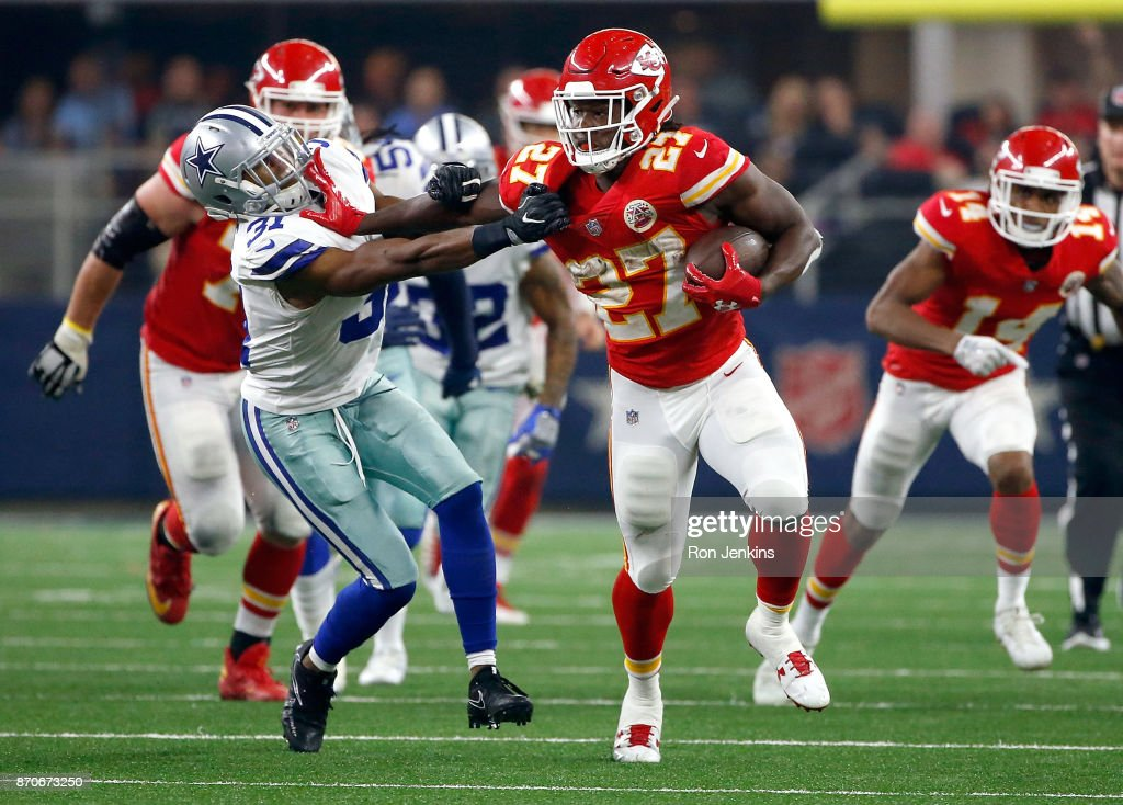 Kareem Hunt #27 of the Kansas City Chiefs holds off Byron Jones #31 of the Dallas Cowboys on a carry in the second half of a football game at AT&T Stadium on November 5, 2017 in Arlington, Texas.