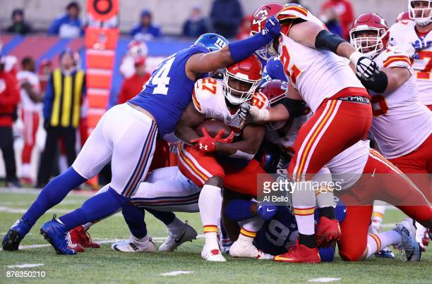 Kareem Hunt of the Kansas City Chiefs is tackled by the New York Giants defense during their game at MetLife Stadium on November 19 2017 in East...