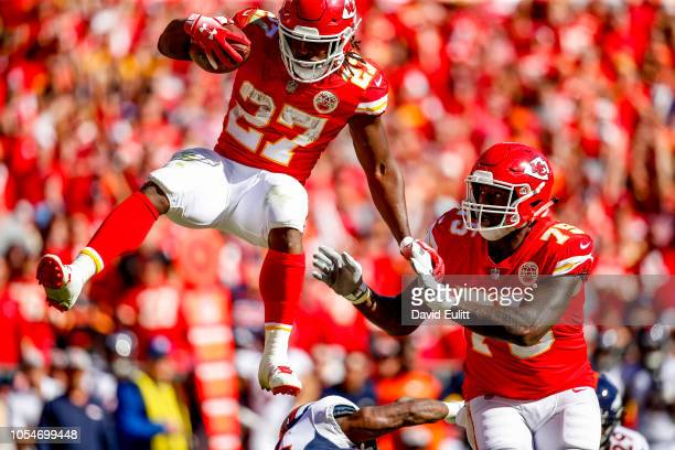 Kareem Hunt of the Kansas City Chiefs leaps over a defender on his way to a touchdown during the third quarter of the game against the Denver Broncos...