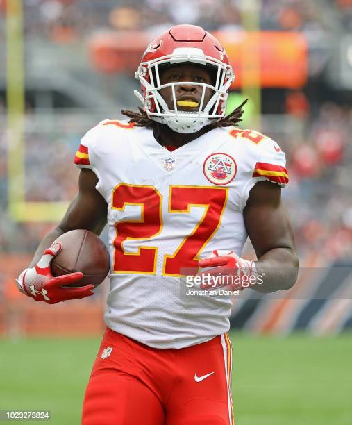 Kareem Hunt of the Kansas City Chiefs runs for a touchdwon agaoinst the Chicago Bears during a preseason game at Soldier Field on August 25 2018 in...