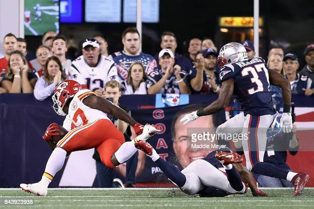 Kareem Hunt of the Kansas City Chiefs runs on his way to scoring a touchdown during the second quarter against the New England Patriots at Gillette...