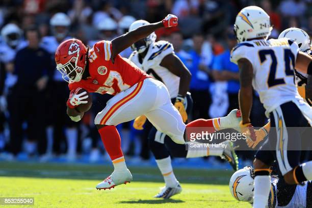 Kareem Hunt of the Kansas City Chiefs runs past Trevor Williams of the Los Angeles Chargers during the second half of a game at StubHub Center on...