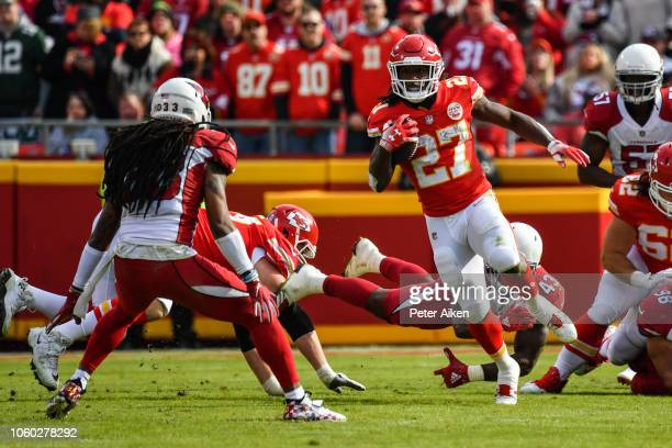 Kareem Hunt of the Kansas City Chiefs rushes the ball in front of the diving tackle attempt of Haason Reddick of the Arizona Cardinals during the...