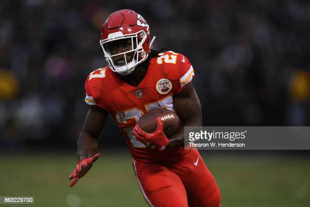 Kareem Hunt of the Kansas City Chiefs rushes with the ball against the Oakland Raiders during their NFL game at OaklandAlameda County Coliseum on...