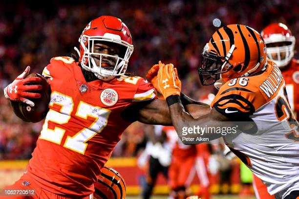 Kareem Hunt of the Kansas City Chiefs stiff arms Shawn Williams of the Cincinnati Bengals on his way to a diving touchdown during the second quarter...