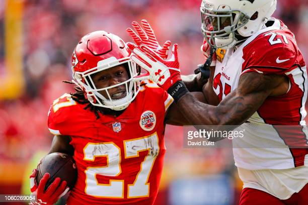 Kareem Hunt of the Kansas City Chiefs tries to fight off a tackle from Patrick Peterson of the Arizona Cardinals during the first half of the game at...