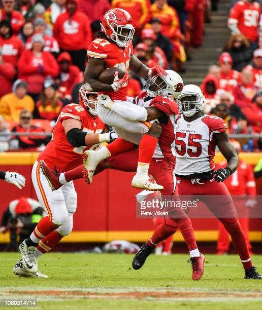 Kareem Hunt of the Kansas City Chiefs tries to hurdle through the tackle attempt of Budda Baker of the Arizona Cardinals during the second half of...