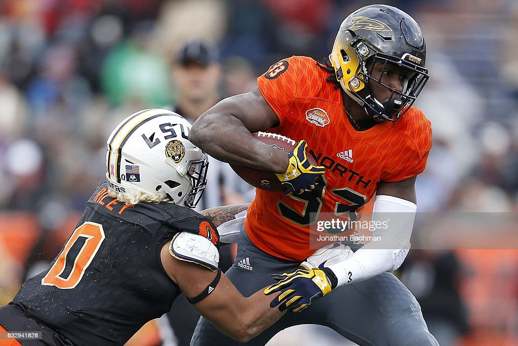 Kareem Hunt #33 of the North team runs with the ball as Duke Riley #0 of the South team defends during the second half of the Reese's Senior Bowl at the Ladd-Peebles Stadium on January 28, 2017 in Mobile, Alabama.