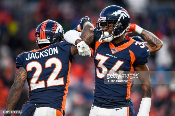 Kareem Jackson and Will Parks of the Denver Broncos celebrate after a fourth quarter defensive stop against the Los Angeles Chargers at Empower Field...
