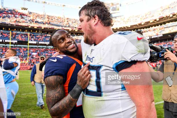 Kareem Jackson of the Denver Broncos and Ben Jones of the Tennessee Titans have a word on the field after the Denver Broncos 160 win at Empower Field...