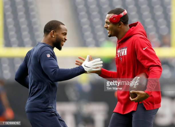 Kareem Jackson of the Denver Broncos and Deshaun Watson of the Houston Texans greet each other during warm ups before the game at NRG Stadium on...