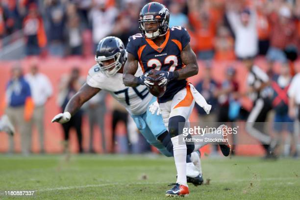 Kareem Jackson of the Denver Broncos carries the ball after making an interception against the Tennessee Titans in the fourth quarter at Broncos...