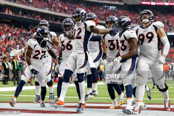 Kareem Jackson of the Denver Broncos celebrates with temmates after an interception in the fourth quarter against the Houston Texans at NRG Stadium...