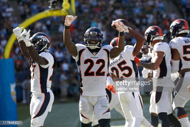 Kareem Jackson of the Denver Broncos reacts after an interception by A.J. Johnson of the Denver Broncos during the second half of a game against the...