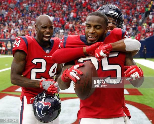 Kareem Jackson of the Houston Texans celebrates with Johnathan Joseph after intercepting after a fourth quarter interception at NRG Stadium on...