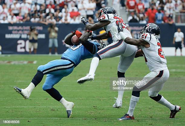 Kareem Jackson of the Houston Texans drops a hit in the second half on ;Kendall Wright of the Tennessee Titans at Reliant Stadium on September 15,...