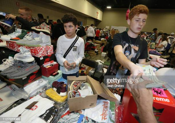Kareem Kowatoli of Orlando and Tarek Kowataoli purchase a pair of sneakers for $1470 to resell during SneakerCon 2019 at Fort Lauderdale Convention...