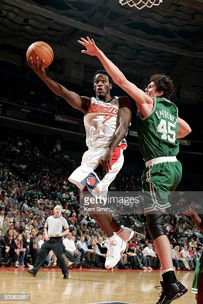 Kareem Rush of the Charlotte Bobcats gets up to the net as Raef LaFrentz of the Boston Celtics trys to block on January 25 2005 at the Charlotte...