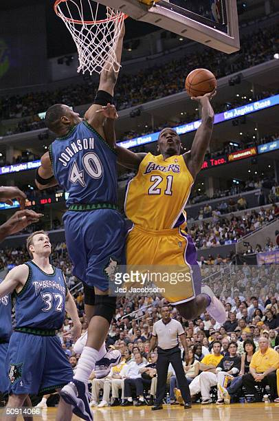Kareem Rush of the Los Angeles Lakers is called for an offensive foul while going to the basket against Ervin Johnson of the Minnesota Timberwolves...