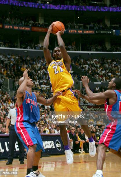 Kareem Rush of the Los Angeles Lakers shoots between Chauncey Billups and Lindsey Hunter of the Detroit Pistons in Game two of the 2004 NBA Finals on...