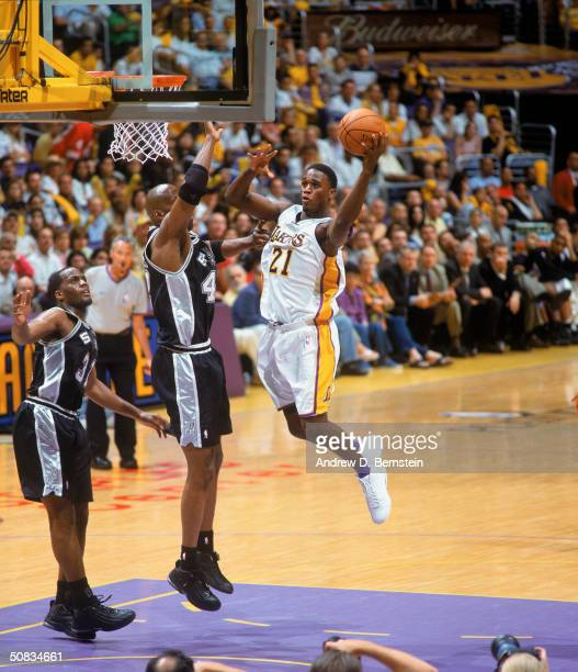 Kareem Rush of the Los Angeles Lakers takes the ball up against Kevin Willis of the San Antonio Spurs in Game Three of the Western Conference...