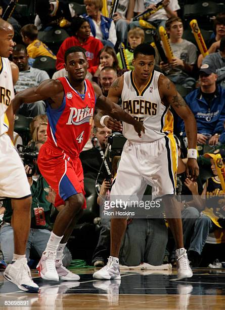 Kareem Rush of the Philadelphia 76ers guards his younger brother Brandon Rush #25 of the Indiana Pacers at Conseco Fieldhouse on November 14 2008 in...