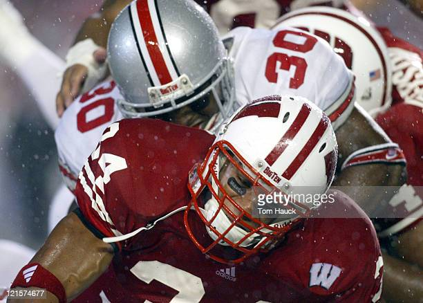 Kareem Timbers Of The Wisconsin Badgers Is Piled On During A Game Against Ohio State