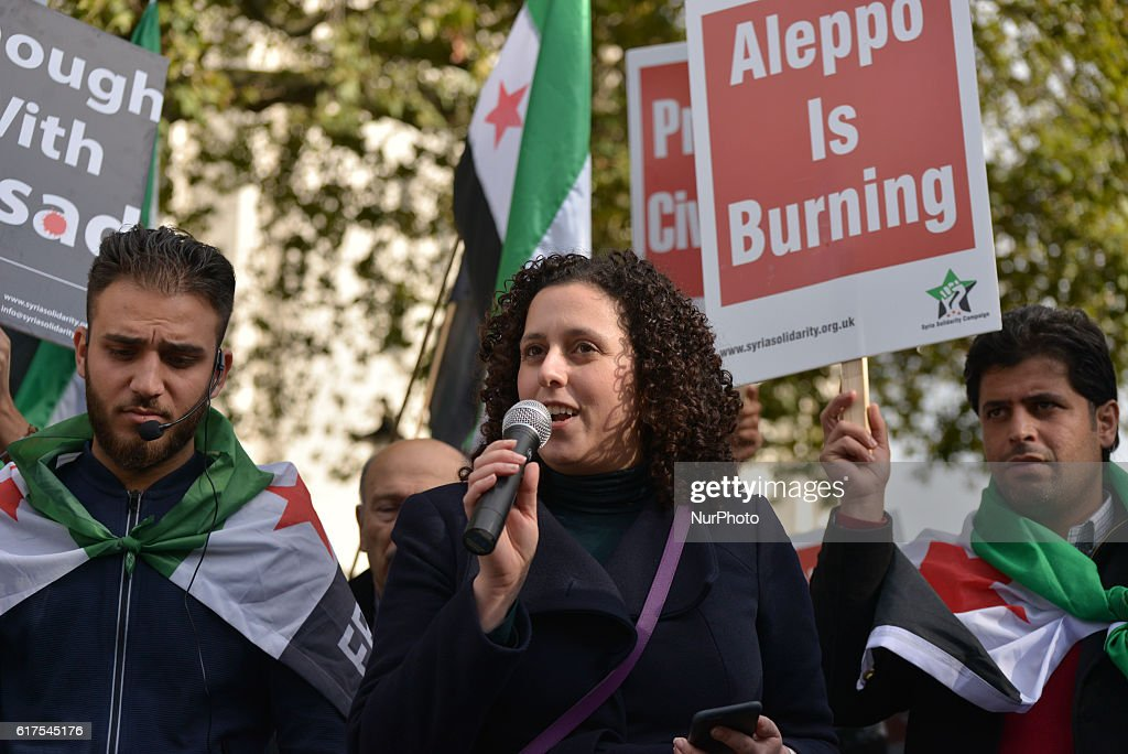 Kareen El Beyrouty, Director of the Syria Solidarity Campaign, speaks at the 'Rally for Aleppo' outside Downing Street on October 22, 2016 in London, England. The protest was held in support of people in Aleppo, Syria and an attempt to stop the violence in the area. The demonstration was organised by Amnesty International UK, Avaaz, Big Heart, Council on Arab British Understanding (CAABU), CARE International UK, Christian Aid, Doctors of the World UK, Human Appeal, International Rescue Committee UK, Syria Relief, The Syria Campaign, War Child, ChildrenPlus and WATAN.