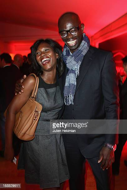 Kareen Guiock and SylvereHenry Cisse attend 'A Decade Of Innovation Inspired By Motor Racing' Cocktail hosted by TAG Heuer at Cyclone Studio on...