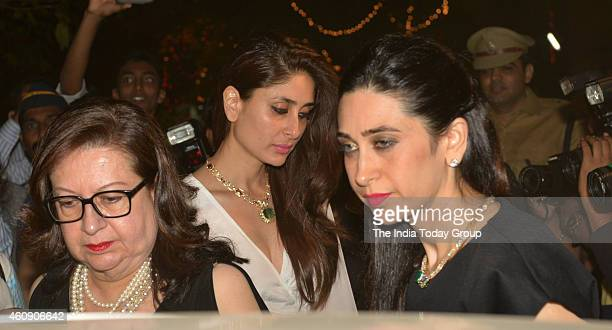 Kareena Kapoor Karishma Kapoor and Babita Kapoor for midnight mass at STAndrews church in Mumbai