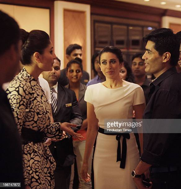 MUMBAI INDIA SEPTEMBER 14 Kareena Kapoor with sister Karishma Kapoor and Designer Manish Malhotra seen at the HT Brunch Dialogues 2 event at Taj...
