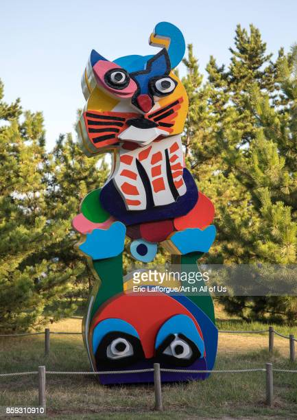 Karel appel frog and cat sculpture in Benesse hotel garden Seto Inland Sea Naoshima Japan on August 24 2017 in Naoshima Japan