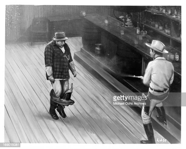 Karel Fiala fires his gun at a man that has his pants pulled down in a scene from the film 'Lemonade Joe' 1964