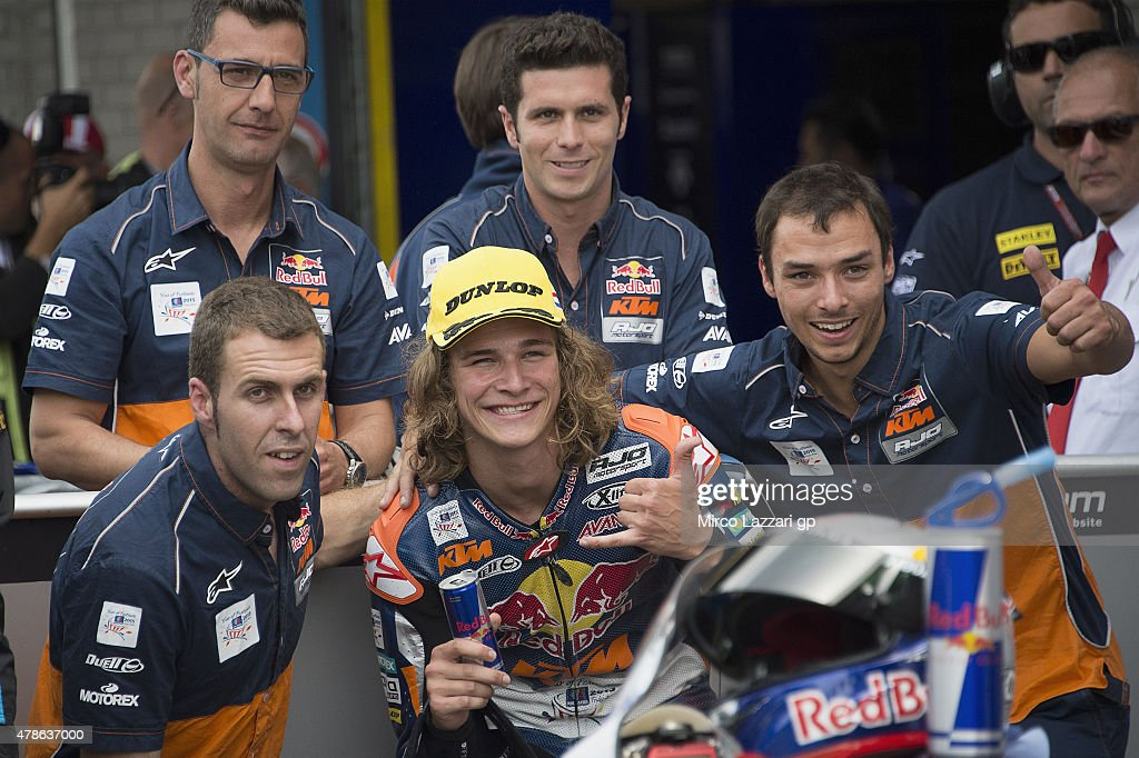 Karel Hanika of Czech and Red Bull KTM Ajo smiles with team at the end of the qualifying practice during the MotoGP Netherlands - Qualifying at TT Assen Circuit on June 26, 2015 in Assen, Netherlands.