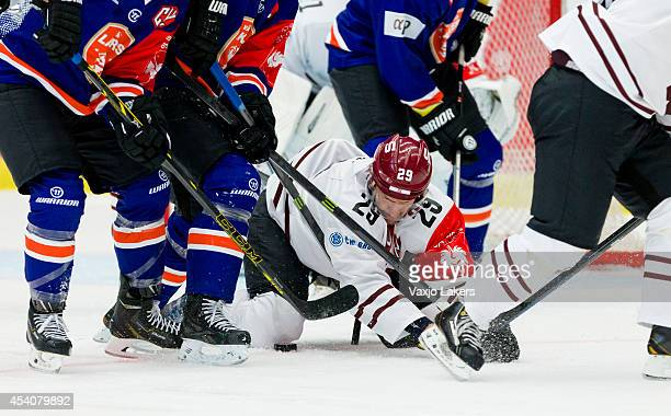 Karel Pilar of Sparta Prague fights for the puck on his knees during the Champions Hockey League group stage game between Vaxjo Lakers and Sparta...
