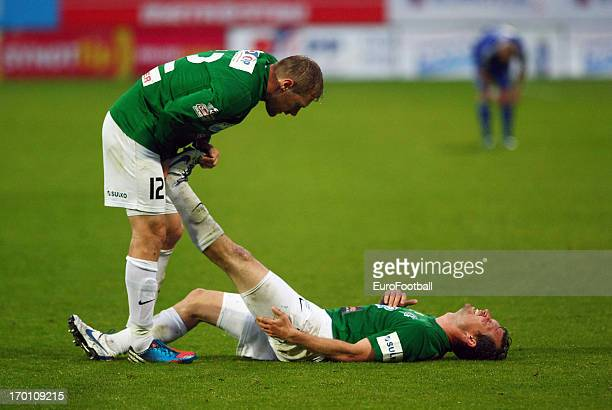 Karel Pitak helps team-mate Tomas Cizek of FK Jablonec to overcome cramp during the Czech First League match between FK Jablonec and SK Sigma Olomouc...