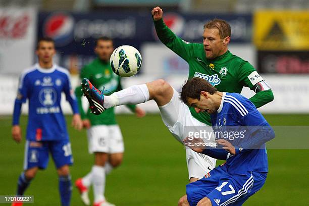 Karel Pitak of FK Jablonec challenges Tomas Horava of SK Sigma Olomouc during the Czech First League match between FK Jablonec and SK Sigma Olomouc...