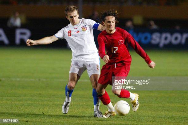 Karel Poborsky of Czech Republic vies for the ball with Turkey's Tuncay Sanli during their friendly football match at Ataturk Stadium in Izmir 01...