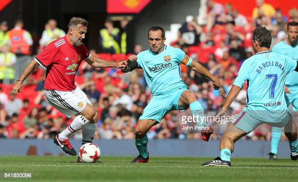 Karel Poborsky of Manchester United Legends in action with Sergi Barjuan of Barcelona Legends during the MU Foundation charity match between...