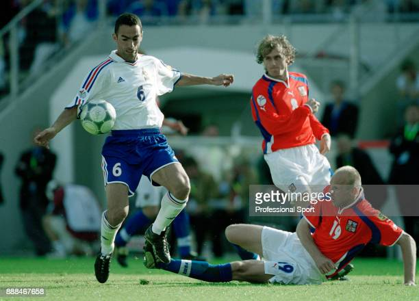 Karel Rada of the Czech Republic attempts to tackle Youri Djorkaeff of France during a UEFA Euro 2000 group match at the Jan Breydel Stadium on June...